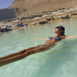 Woman floating in the Dead Sea, En Bokek, Israel, Middle East
